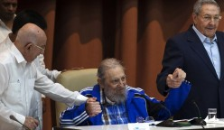 2016 AP YEAR END PHOTOS - Fidel Castro sits as he clasps hands with his brother, Cuban President Raul Castro, right, and second secretary of the Central Committee, Jose Ramon Machado Ventura, moments before the playing of the Communist party hymn during the closing ceremonies of the 7th Congress of the Cuban Communist Party, in Havana, Cuba, on April 19, 2016. (Ismael Francisco/Cubadebate via AP, File)