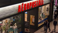 Shoppers passing by Aeropostale retail store inside a mall,