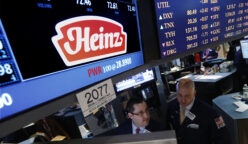 Traders work at the post that trades H.J. Heinz Co. on the floor of the New York Stock Exchange