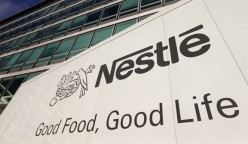 The Nestle logo is pictured on a truck outside the company's headquarters before the nine-month sale figures news conference in Vevey October 17, 2013. Nestle said still-weak emerging market demand and falling prices for its products in Europe slowed underlying sales growth to 4.4 percent in the first nine months of the year from 6.1 percent in the year-ago period. Nestle's sales growth in Asia, Oceania and Africa accelerated slightly to 6.9 percent from 6.3 percent in the first half, while growth in Europe rose to 0.9 percent from 0.6 percent in the first half with still negative pricing. REUTERS/Denis Balibouse (SWITZERLAND - Tags: BUSINESS LOGO FOOD) - RTX14EFM