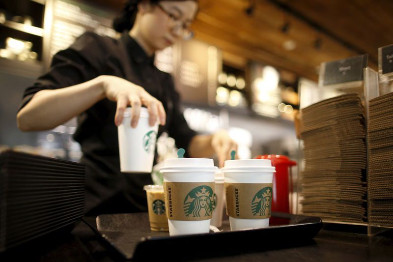 A staff serves beverages at a Starbucks coffee shop in Seoul